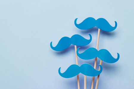 Blue moustache on a Blue background. Prostate cancer awareness month Stock Photo
