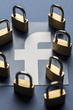LONDON, UK - OCTOBER 25th 2018: Facebook data security concept. A set of padlocks with the facebook social media