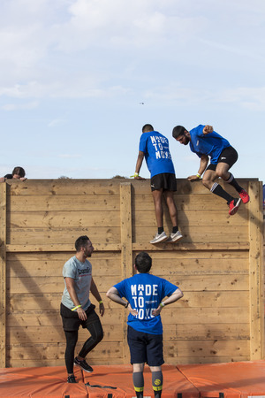 LONDON, UK - September 13th 2018: Participants take part in a Tough Mudder 5K obstacle race in London.