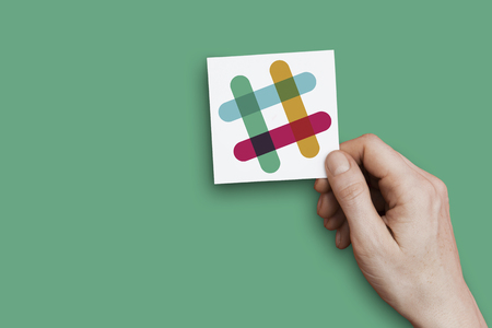 LONDON, UK - October 30th 2018: Hand holding a Slack icon. Slack is a cloud based collaboration tool. Editorial