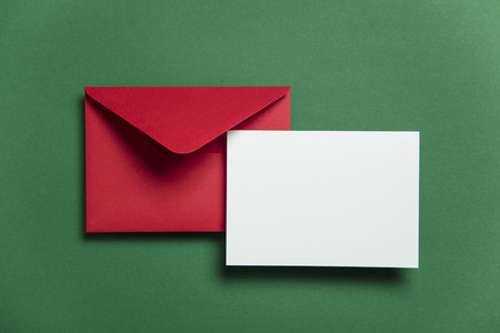 Blank white card with red paper envelope Christmas card template mock up.