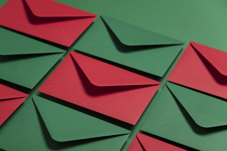 Red and green paper envelopes. Christmas card template mock up. Stock Photo