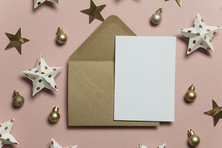 Christmas card template mock up. Blank card with envelope on pink background