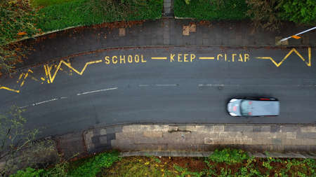 Aerial view of a school keep clear road sign in the UK 免版税图像