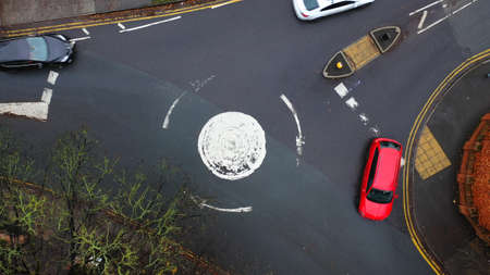 Aerial view of a roundabout road junction in the UK