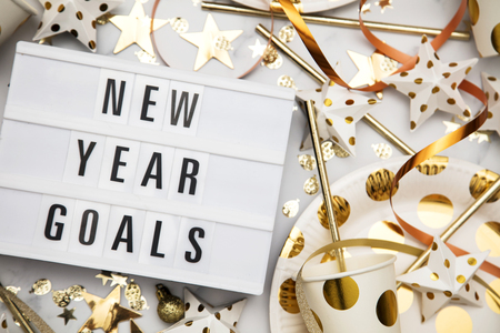 New year goals lightbox celebration message with luxury gold party decorations