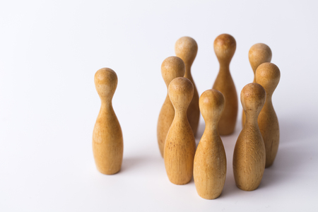 wooden figure stands out from the crowd. Business leadership concept