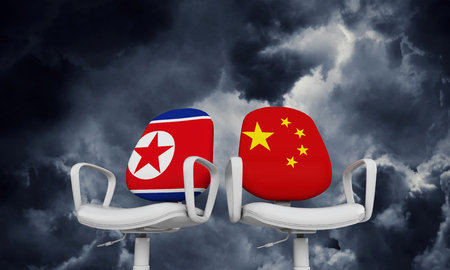 North Korea and China business chairs. International relationship concept. 3D Rendering