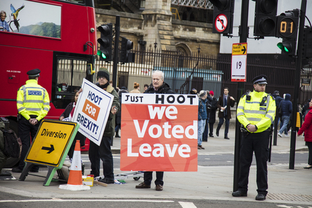 LONDON, UK - JANUARY 15, 2019: Brexit suporters, brexiteers, in central London holding banners campaigning to leave the European Union.