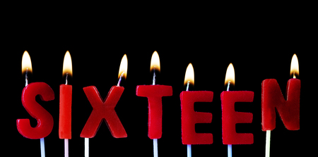 Sixteen spell out in red birthday candles against a black background