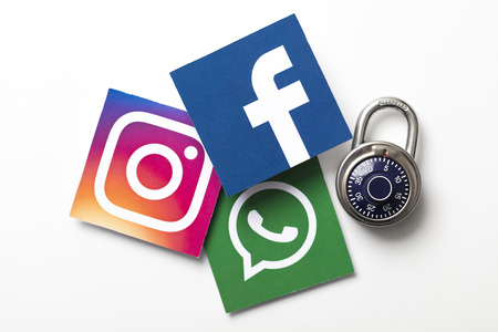 LONDON, UK - FEBRUARY 8th 2019: Facebook, Instagram and Whatsapp logos printed onto paper.