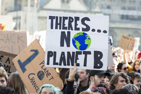 LONDON, UK - February 15, 2019: Protestors with banners at a Youth strike for climate march in central London 에디토리얼