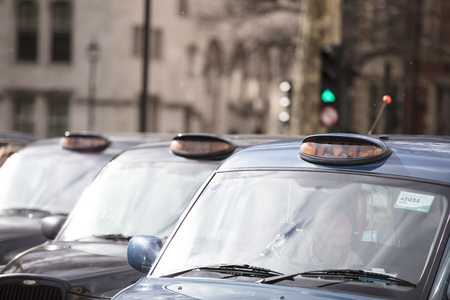 Taxis block roads in Westminster in protest