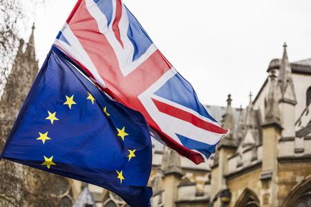 European Union and British Union Jack flag flying together. Stock Photo