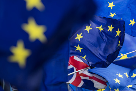 Flags of the European Union flying at a brexit march in London Stock Photo