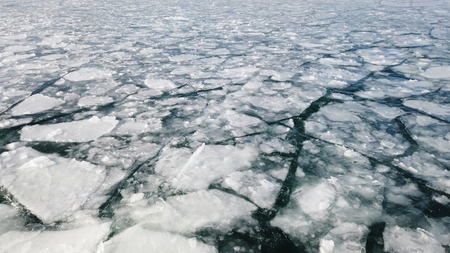 Cracked ice on the surface of the sea. climate change concept
