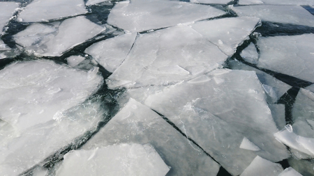 Frozen surface of the ocean cracked. extreme weather
