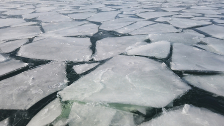 Global warnimg concept. Cracked ice on the surface of the ocean.