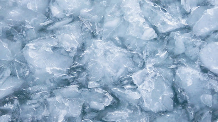 Close up of the ocean frozen over. melting and cracking. Climate change