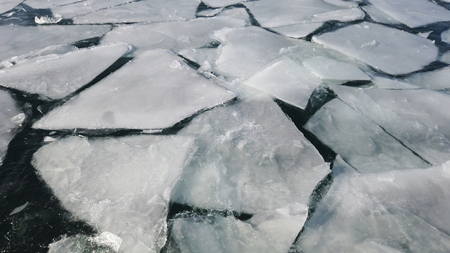 Cracked ice on the surface of the ocean. Global warnimg concept Stock Photo