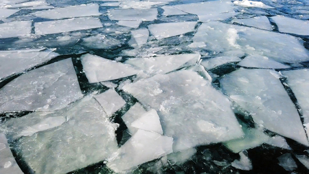 Arctic ice melting and cracking on the surace of the sea Stock Photo