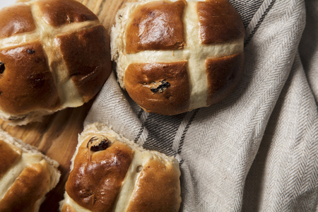 Traditional hot cross buns with raisins. Easter springtime treat
