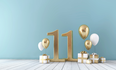 Number 11 party celebration room with gold and white balloons and gift boxes.