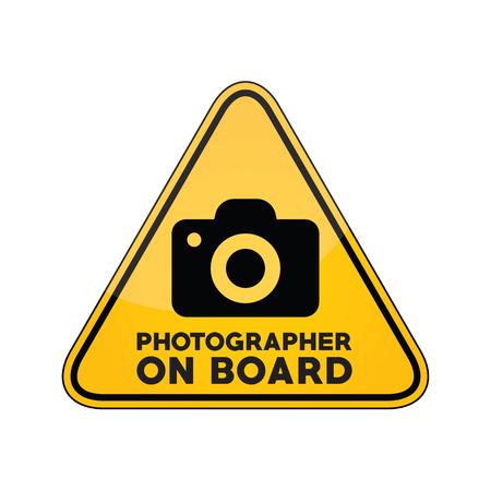 Photographer on board yellow car window warning sign