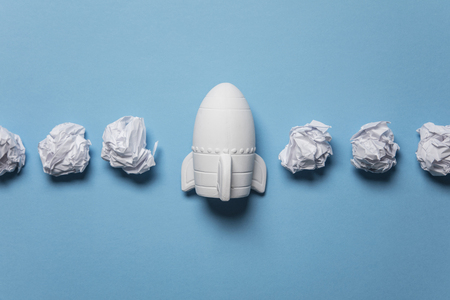 Business startup concept. Rocket taking off with crumpled paper trail Banco de Imagens