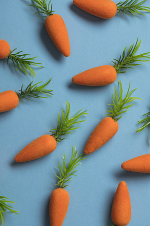 Easter bunny carrots on a blue background Stok Fotoğraf - 123233864