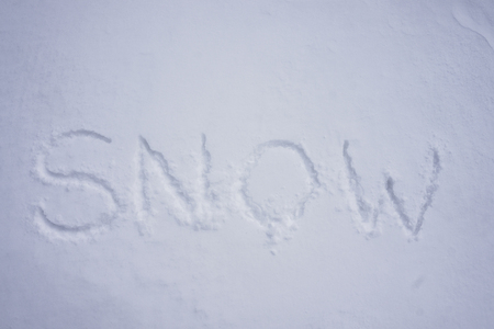 Snow word written in a cold snow background Stock Photo