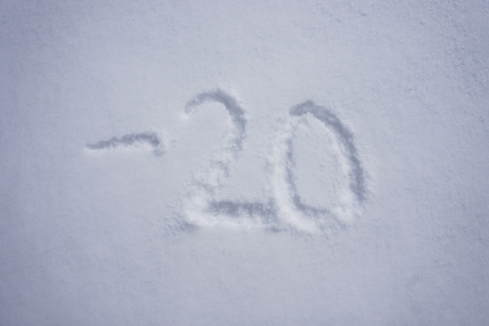 minus 20 degree celsius written into a snow background Stock Photo