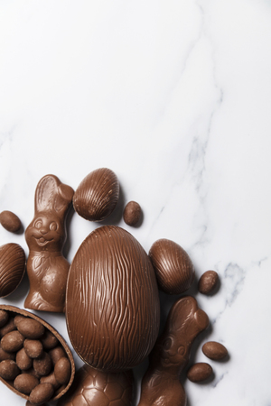 Chocolate easter eggs and bunnies on a marble background
