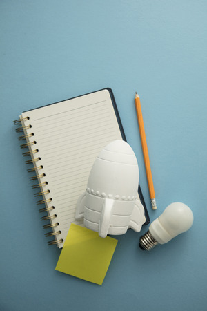 Business Launch. Rocket ship with notepad. Business development concept