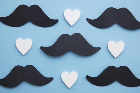 Black mustache with love hearts. Fathers day or mens health concept