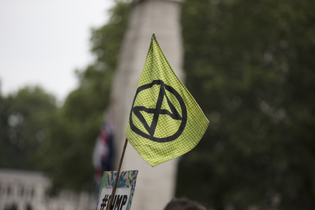 LONDON, UK - June 4th, 2019: Extinction Rebellion flags flying at a protest