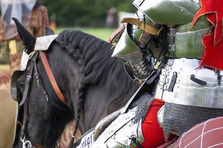 Close up of a medieval knight wering armour sitting on horseback Stok Fotoğraf