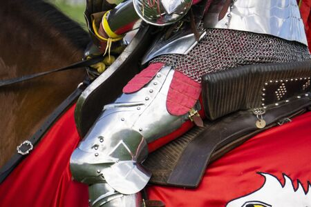 Close up of a medieval knight wering armour sitting on horseback Banco de Imagens