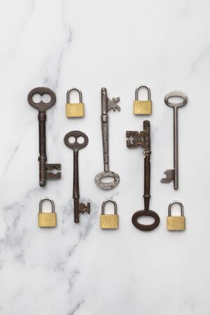 Vintage keys and padlocks overhead lay flat composition. Security concept Stock Photo