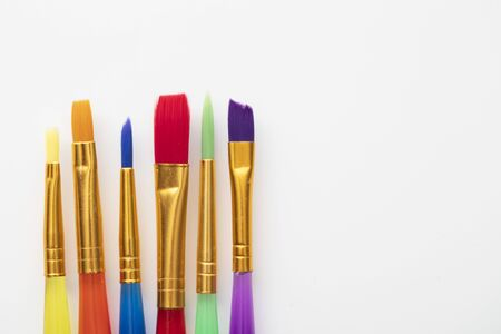 Colourful creative paintbrush art supply background Фото со стока
