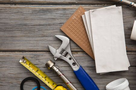 Plumbing tools and tiles. Home improvement background