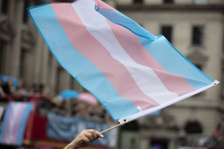 A transgender flag being waved at LGBT gay pride march 版權商用圖片