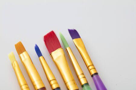 Colourful creative paintbrush art supply background Stok Fotoğraf