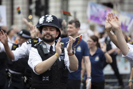 LONDON, UK - July 6th 2019: Police officers take part in the annual gay pride march in central London Redakční