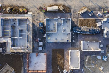 Aerial view over a construction site of new homes being built