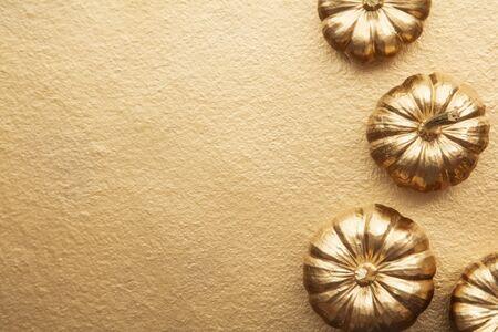 Golden thanksgiving pumpkin overhead flay lay composition