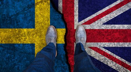 Business man stands on cracked flag of UK and Sweden. Political concept Stockfoto
