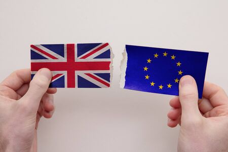 UK and Europe paper flags ripped apart. political relationship concept