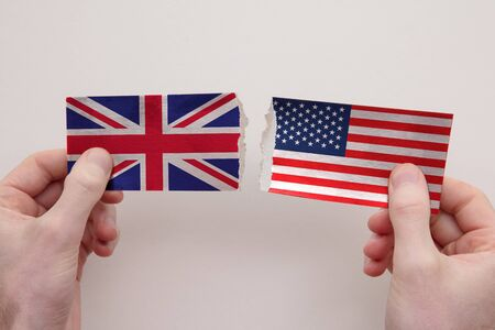 UK and USA paper flags ripped apart. political relationship concept 写真素材