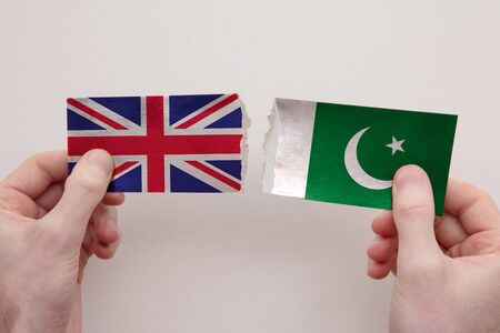 UK and Pakistan paper flags ripped apart. political relationship concept Stock fotó